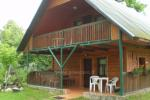 Holiday cottage in a homestead on the shore of the lake Vyšnia