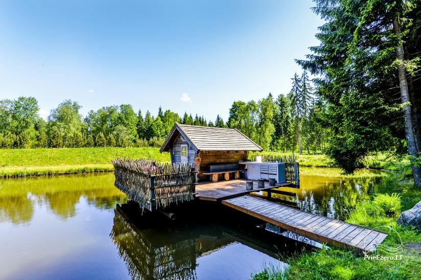 Miško rojus - hut over water - 1