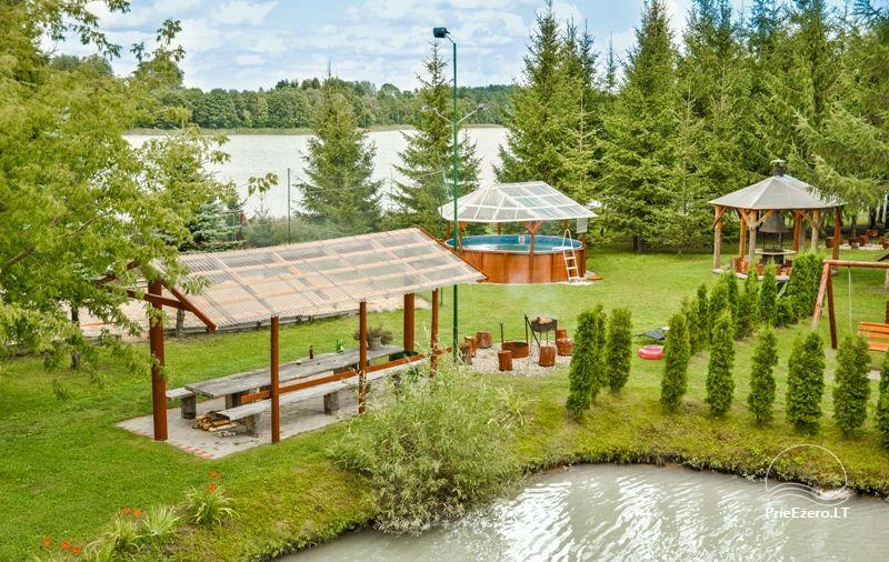 Holiday cottages, bathhouse, hot tub, kayaks in homestead at the lake Dviragis - 54